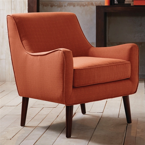 Featuring mid-century-inspired curves, this Orange Fabric Upholstered Mid-Century Style Arm Chair adds a soft contrast to a clean-lined upholstered room. Flame retardant: Yes; Chair Design: Arm chair; Upholstery Material: Polyester/Polyester blend; Cushion or Upholstery Fill Material: Foam; Pattern: Solid. Non-Toxic: Yes; Removable Seat Cushion: Yes; Removable Back Cushion: No; Reversible Cushions: No; Welt on Cushions: Yes; Tufted Cushions: No. Arm Material: Fabric; Wood; Arm Type: Track arms; Legs Included: Yes; Leg Finish: Espresso; Leg Material: Wood; Removable Legs: Yes.
