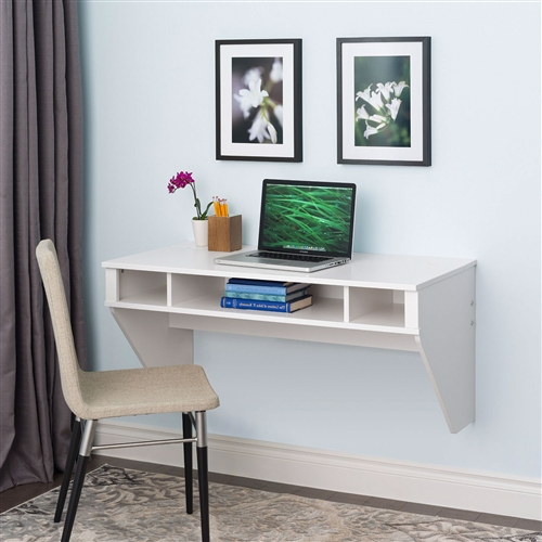 """Optimize your space with this White Space Saving Laptop Tablet Computer Desk Wall-Mount at any Height. Perfectly suited for any home office, den, living room, kitchen or bedroom. The stable work surface is ideal for any computer or simply as a place to get your work done. A rear """"flip-up"""" door conceals a storage compartment that is ideal for power bars and adapters. No more messy wires cluttering up your workspace! Installation is a breeze for this wall mounted desk with this innovative hanging rail system. Proudly manufactured in Canada using CARB-compliant, laminated composite wood. Ships Ready to Assemble, includes an instruction booklet for easy assembly and has a 5-year manufacturer's limited warranty."""