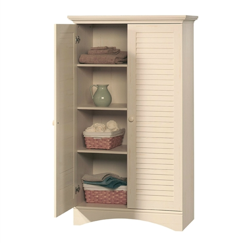 The perfect easy-living cottage look. Louvered door panels, turned wood feet and worn wood knobs complete this vision of warmth and charm. This Vintage Antique White Wood Finish Wardrobe Armoire Storage Cabinet with Louver Doors has soft hints of brown grain that will complement most room settings. Using the adjustable shelves you can have hidden storage for any size item. Perfect for any room in the house.