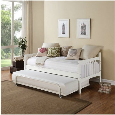 This Twin size Daybed in White Wood Finish - Trundle Sold Separately is a versatile piece of furniture that can cover both seating and sleeping needs. Featuring clean lines with a beautiful finish, this daybed will blend in with most any decor. You can use it plain or dress it up with decorative pillows for an added stylish touch. Its solid wood frame makes it sturdy and durable, while the wooden slat details add a classic touch. A box spring is not required, and the mattress is sold separately. You can use this wooden daybed to provide extra sleeping accommodations for guests. It will work well in a guest room, den or in a small living space because of its compact size. The Twin size Daybed in White Wood Finish - Trundle Sold Separately can also accommodate a trundle or allow for extra storage space underneath. 9 Slats; Perfect for use in a guest room or den; Full-size mattress and a trundle can fit underneath the daybed; The daybed is compatible with a twin sized mattress; Includes the twin part of the daybed; You can use a pop up trundle with this bed; Style: Traditional; Mattress Included: No.