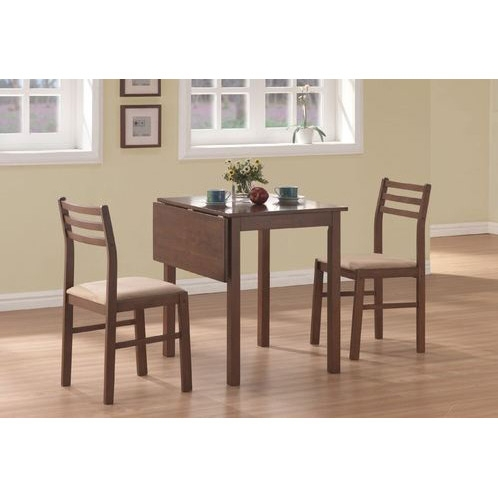 This 3-Piece Drop-Leaf Square Dining Set in Walnut Finish offers classic styling that will blend with any decor. The table features a solid-top drop leaf, straight edges and sleek square legs. The armless side chairs feature a ladder back design with padded upholstered seating for comfort. The clean lines of this set paired with a warm walnut finish, will help create a timeless look that you and your family will love.