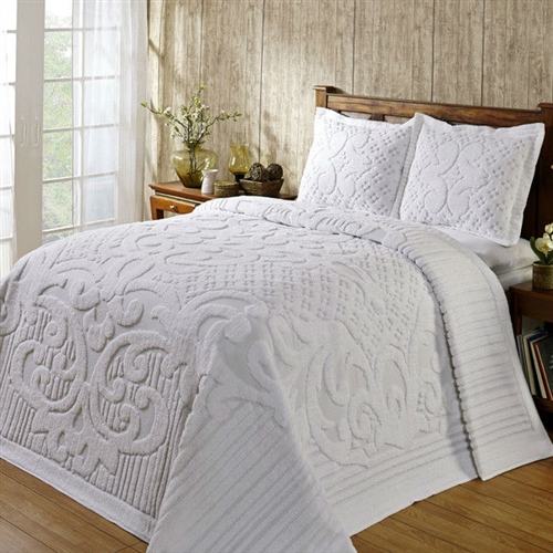 This Queen size 100-Percent Cotton Chenille Bedspread in White will make your bedroom cozy and warm with its pleasing colors and pattern. It has a solid color with tufted scrolls, lines and dots. Bedspread only, pillowcases not included; American style; Style: Contemporary; Reversible: Yes. Country of Manufacture: India