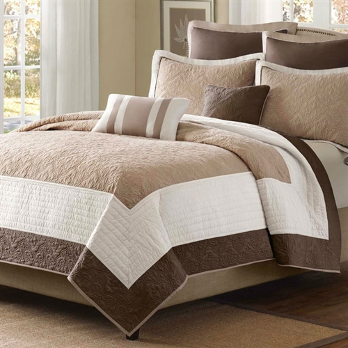 King Brown Ivory Tan Cream 7 Piece Quilt Coverlet Bedspread Set. Beautifully made from polyester and microsuede, this set is soft and comfortable. This set is made with a quilted and self-fabric binding technique that gives it a smooth texture and provides you with exceptional comfort when you rest in it. The set includes one quilted coverlet, two shams, two euro shams, and two pillows with great designs that will complete your bed in style. It has beige and ivory blend color that blends with most decor and settings This stylish set is a perfect inclusion for any home.