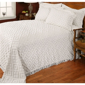 "Bring an elegant look to your bedroom with this Full size Diamond Pattern Cotton Chenille Bedspread in White. The 100% Cotton Chenille Bedspread features allover tufted designs with 2"" fringe on the bottom edge. Coordinating sham available (sold in eaches.) For chenille bedspreads, choose Twin, Full, Queen, or King; Flanged Standard Sham mimics the bedspread and has a French back closure; Diamond Chenille Bedspreads are made from 100% plush cotton."