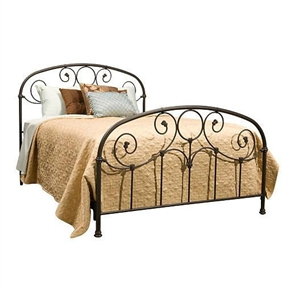 This Full size Metal Bed with Softly Rounded Shoulders in Rusty Gold Finish would be a great addition to your home. The prominent scrollwork on this head and footboard is secured in place with decorative banding. And the 12 solid castings give the bed a playful character not found in most iron beds. The heavy tubing creating the overall shape of the bed display softly rounded shoulders that give historic appeal. Another elevating feature to the bed is the finish. It carries an intricacy that may not be noticed at first glance. When viewed up close the finish glows with an inner warmth that warrants the name Rusty Gold, and makes it a perfect match for a warm toned bedding ensemble.