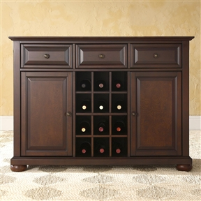 This Dining Room Organizer Sideboard Server Buffet Cabinet in Vintage Mahogany merges clean modern lines and traditional raised panel doors to create a strong, solid place to store and display your favorite serving pieces. Three deep drawers sit just below the server's top, which can be used to store silverware, linen napkins, wine bottle openers and more. The stunning open air center storage area was designed for versatility. The dividers allow you to store up to 12 standard bottles of wine. They can also be removed to create two open shelves to display your favorite serveware. The legs boast adjustable levelers, for maximum stability. The fully finished back allows you to place this against a wall or in the open and still look magnificent from all angles. Product Care: Use a soft clean cloth that will not scratch the surface when dusting. Use of furniture polish is not necessary. Should you choose to use polishes, test in an inconspicuous area first. Use of solvents of any kind may damage your furniture's finish. To clean, simply use a soft clean cloth moistened with lukewarm water, buff with a dry soft clean cloth. Adjustable shelf behind each door; Adjustable levelers in legs; ISTA 3A certified; Constructed of solid hardwood and veneer; Center storage area can hold up to 12 wine bottles; Manufacturer provides a 90 day warranty against defects in material and workmanship; Product Type: Server; Number of Drawers: 3; Number of Cabinets: 2; Number of Interior Shelves: 4; Number of Doors: 2; Wine Rack Bottle Capacity: 12; Assembly Required: Yes; Product Warranty: 90 Day limited warranty.