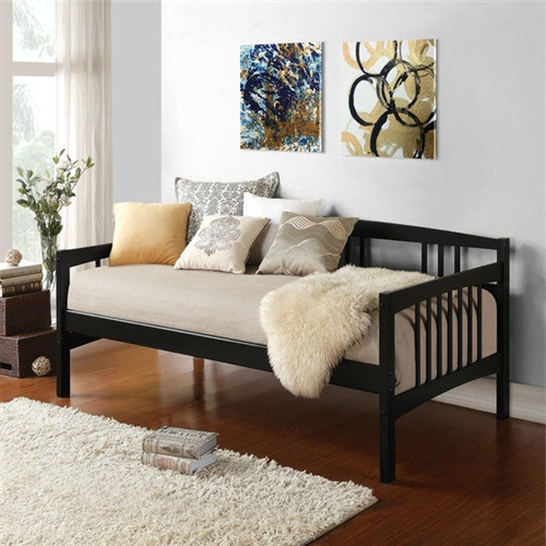 "Twin size Black Solid Wood Day Bed Frame with Wooden Slats: Product Code: BKDB49851481 : This Twin size Black Solid Wood Day Bed Frame with Wooden Slats is a versatile piece of furniture that can cover both seating and sleeping needs. Featuring clean lines with a beautiful finish, this daybed will blend in with most any decor. You can use it plain or dress it up with decorative pillows for an added stylish touch. Its solid wood frame makes it sturdy and durable, while the wooden slat details add a classic touch. A box spring is not required, and the mattress is sold separately. You can use this wooden daybed to provide extra sleeping accommodations for guests. It will work well in a guest room, den or in a small living space because of its compact size. The Twin size Black Solid Wood Day Bed Frame with Wooden Slats can also accommodate a trundle  (sold separately) or allow for extra storage space underneath.  Functional piece can be used either as a bed or as extra-deep seating; 9 Slats; Perfect for use in a guest room or den; Twin size mattress/trundle would fit; The daybed is compatible with a twin sized mattress; Includes the twin part of the daybed; You can use a pop up trundle with this bed; Space under the bed: 12.9""; Material Pine wood; No particular trundle bed for this daybed; Daybed will hold up to daily use; Style: Traditional; Frame Material: Wood; Mattress Included: No. Daybed Weight Capacity: 225lbs. Country of Manufacture: Vietnam; Product Warranty: 1 Year limited warranty."