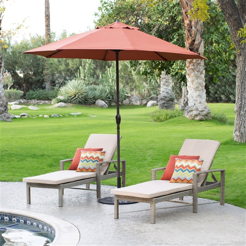 9-Ft Patio Umbrella in Terracotta with Metal Pole and Tilt Mechanism, TPUB596181 :  Try as you might, you simply won't find a more affordable auto tilt patio umbrella with a durable Olefin fabric shade than this 9-Ft Patio Umbrella in Terracotta with Metal Pole and Tilt Mechanism. It's all in the engineering. This unique umbrella raises the tilt joint position on the frame (tilt mechanism). This unique design distributes weight away from the joint, resulting in a far lower chance of breakage compared to other auto-tilt products. This allows the tilt joint to be made from a lighter weight material instead of costly metal. The auto-tilt feature conveniently allows you to adjust the pitch of the umbrella shade to block the sun. Simply use the crank to open the umbrella, then continue turning until you get to the desired shade pitch.