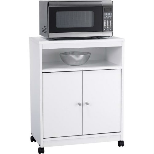 Dinner prep and kitchen storage just got easier, thanks to this White Utility Cart / Kitchen Microwave Cart with Casters. Perfect in any kitchen, the cart is a kitchen utility unit that offers space for your microwave and many other items. Two cabinet doors open to a large storage area, ideal for keeping cereals, snacks, chips, bottled water and other foods. Or, use it to conceal your various serveware, plastic containers, lids and other items that usually clutter your countertops. An additional open compartment above the doors is perfect for placing bowls, cups and more. The kitchen utility cart is on wheels, making it easy to move around your space. Simply roll it out when you need and place it back against a wall when you're done. The cart is designed in a crisp white finish with solid metal handles, making it an attractive addition to any home. Easy to assemble with household tools.