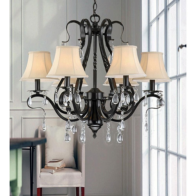 Brighten your home decor with this Black Iron 6-light Crystal Chandelier. This light will add an element of distinction and elegance to your home. This fixture needs to be hard wired. Professional installation is recommended.