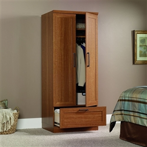 Featuring our warm, contemporary Sienna Oak finish and framed doors, this Sienna Oak Wardrobe Clothes Storage Cabinet Armoire provides the multi-purpose storage system and the right amount of style to fit any room. Adjustable base levelers; Framed panel doors.