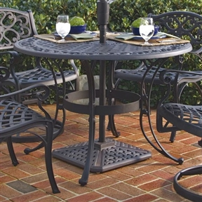 42-inch Round Black Metal Outdoor Patio Dining Table with Umbrella Hole, RBPT658181914 :  Add a hint of style to the backyard, lawn, deck, or patio with this 42-inch Round Black Metal Outdoor Patio Dining Table with Umbrella Hole. This stylish dining table has an intricately designed metal work that gives it an elegant charm that makes it unique from the rest. The outdoor dining table is round and can be coupled with matching chairs for a wholesome look. Designed for the outdoors, this 42-inch Round Black Metal Outdoor Patio Dining Table with Umbrella Hole is made from premium materials that keep it strong and sturdy for years to come. The dining table has a non-toxic powder coated finish that does not fade away easily. It is available in multiple finish options, so you can choose the perfect one for your home or office without much hassle. Even the table top is available in multiple sizes. The nylon glides on all table legs keep it stable on the ground and does not tilt or wobble. This dining table sports a lovely top that has center opening to accommodate umbrella, ensuring protection from the harsh sunlight or rain. This beautiful dining table is easy to clean and maintain. Regularly wipe the end table with a dry, clean cloth and it will look new for long. Durable, lasting year after year; Maintenance free; Cast aluminum construction; Water Resistant Details: Table top's design prevents damage caused by pooling by allowing water to pass freely; Product Warranty: One Year Limited Manufacturer Warranty; FSC Certified: Yes.