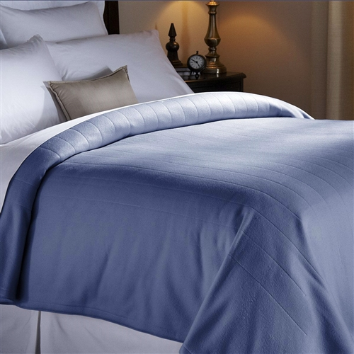 Climb into your toasty bed and sleep soundly in this Twin size Quilted Fleece Heated Electric Blanket in Blue Lagoon. The exclusive Thermofine warming system senses and adjusts temperature to deliver. Quilted channel design; Machine washable and dryer safe; 100% polyester; 160 GSM per side (320 total); Channeled construction; Hem finish.
