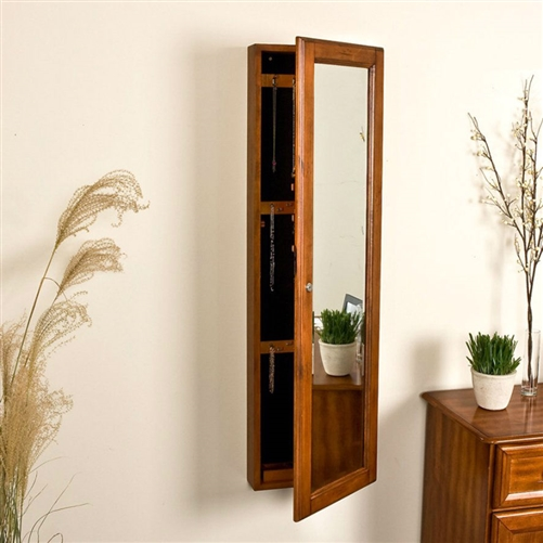 Wall Mount Jewelry Armoire Cabinet and Mirror in Oak Wood Finish, WMJAB8519814 :  This Wall Mount Jewelry Armoire Cabinet and Mirror in Oak Wood Finish looks like an ordinary full-length mirror as it hangs on the wall. However, when you open the cabinet door, you realize that this is a complete jewelry cabinet that can hang anywhere, even in the closet or bathroom. The slim profile of the cabinet hides the fact that the interior is designed to house rings, bracelets, necklaces, and any other jewelry, both large and small. The interior panels are padded and lined with hunter green felt so that your collectibles are not damaged by the wood and the wood is not scratched by any jewelry. The lockable door lets you store your valuables with confidence. The Wall Mount Jewelry Armoire Cabinet and Mirror in Oak Wood Finish is available in a variety of finishes to coordinate with your existing decor. Features ring pads and hooks for necklaces and bracelets; Finish White, Oak, Espresso; Size XL;     Chest Style Traditional, Mission, Louis Philippe, Contemporary, Girls and Teens.