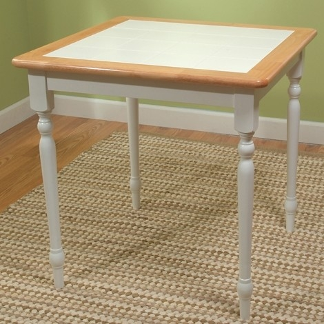 This Classic Square Wood Dining Table with White Tile Top would be a great addition to your home. It has a classic style and a natural white finish. Top Material Details: Hardwood, ceramic tiles; Base Material Details: Hardwood; Assembly Required: Yes; Top Material: Tile; Wood; Base Material: Wood; Non-Toxic: Yes; Seating Capacity: 4; Table Base Type: Four leg; Product Care: Wipe clean with a dry cloth.