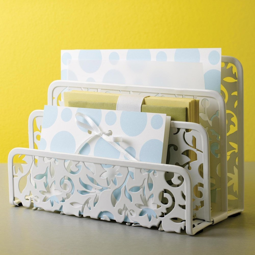 This White Metal Letter Holder with Floral Pattern will add a touch of elegance to organizing. made with industrially stamped steel. coated in durable white epoxy.