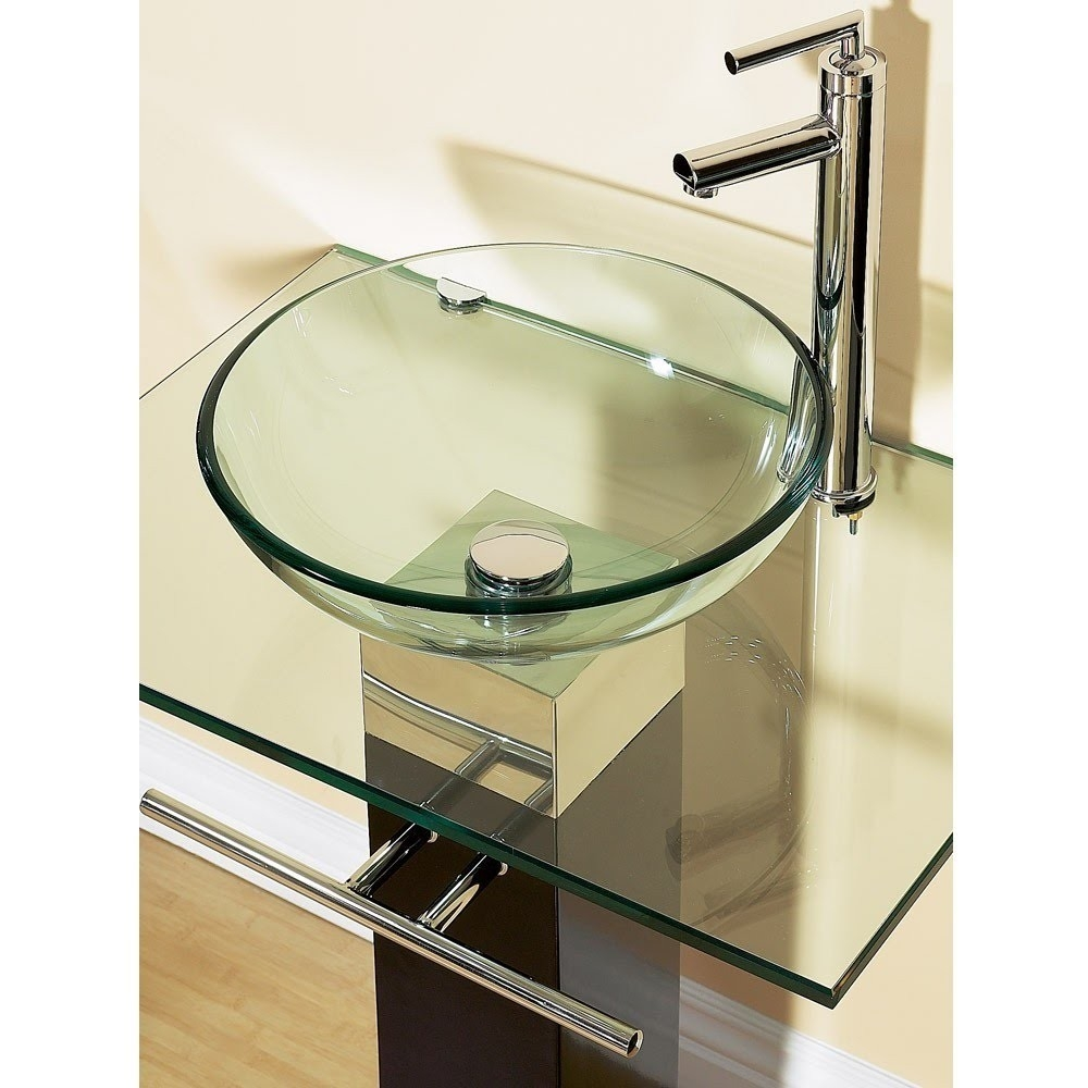 23-inch Bathroom Vanity Set with Clear Glass Sink, K23BV27569 :  Inspired by Swiss and Italian design, this 23-inch Bathroom Vanity Set with Clear Glass Sink features a glass vessel sink mounted on a glass counter-top and a wooden pedestal. The sink is fitted with a stylish, chrome-finish brass faucet and pop-up drain.  Materials: glass, wood; Contains beautifully crafted solid brass faucet; Set includes wood pedestal, glass vessel sink, faucet and plumbing parts; Includes solid brass hardware; Chrome finish; Pedestal-back of it is opened for plumbing configuration; Style: Modern Base; Material Details: Stainless steel; Assembly Required: Yes; Product Warranty: 1 Year. Additional Parts Required: No; Top Finish: Clear; Hardware Finish: Chrome; Base Material: Metal; Top Material: Glass; Water Resistant: Yes; Stain Resistant: Yes; Rust and Corrosion Resistant: Yes; Fire Resistant: Yes; Mold and Mildew Resistant: Yes.