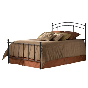 This Queen size Metal Bed with Rounded Posts in Antique Brass Finish combines elements of classical European baroque architecture with the simplistic style of the modernist period. Straight-lined spindles are accented with ornamental scalloped castings and rounded posts are completed with delicate foot castings and finials. The glazed brass finish is perfected by patina, complementing the aesthetics of the piece nicely, while still maintaining the gloss of a new brass bed frame. Warm your bedroom space with touches of old and new style with the bed