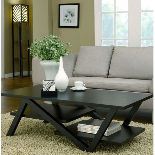 Classic style meets modern artistry! All eyes will notice this Z-Shaped Black Wood Coffee Table with Modern Floating Shelves in a classic black finish. Features intriguing floating-effect shelves and Z-shape leg that is both unique and eye-catching. Two elevated shelves supported by Z-shaped wooden support legs; Design: Table; Features: Shelves; Product Category: Coffee & Cocktail Tables; Shape: Rectangle; Style: Transitional.