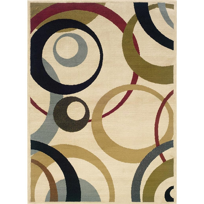 Ivory Geometric Circles Area Rug (7'10 x 10'), IGCAR710X10 :  A striking geometric pattern of circles in various sizes and colors highlights this Ivory Geometric Circles Area Rug (7'10 x 10'). Vibrant hues of deep blue-green, sea foam, olive, gold and magenta complete this ivory floor rug. All rug sizes are approximate. Due to the difference of monitor colors, some rug colors may vary slightly. We try to represent all rug colors accurately. Please refer to the text above for a description of the colors shown in the photo. Tip: We recommend the use of a non-skid pad to keep the rug in place on smooth surfaces. Primary materials: Polypropylene; Pile height: 0.394 inches; Primary color: Beige; Secondary colors: blue, gold, olive, magenta, sea foam.