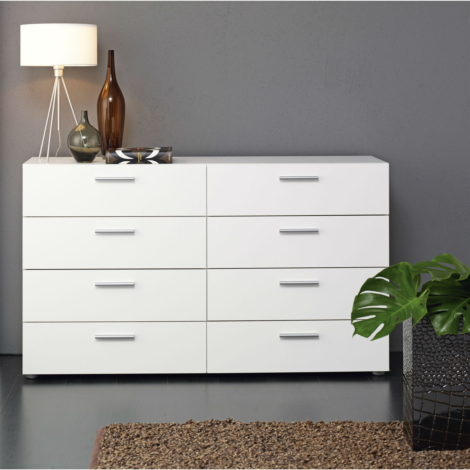 Luxury meets functionality to give you the very best in this White Modern Bedroom 8-Drawer Double Dresser. It lets you embellish any room in the home, and adds a touch of tasteful fine art to the decor. The chest is the best way to give a contemporary look to your interior design. The solid metal hardware has long lasting usability. Moreover, it comes with levelers to ease the installation part. Dresser is made for a heavy duty performance and stays put in its place. The glint on the surface of this dresser is due to the foil surface used in its finishing. It offers premium space for storing essentials as you wish. Use it in the bedroom for the clothes, or in the living room to provide a stable structure for the television, it just comes alive in any corner and adds a spark wherever it is placed. ISTA 3A certified; Levelers included; Frame Material: Wood; Product Type: Standard dresser (horizontal).