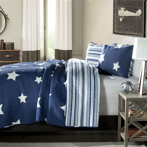 King Navy Stars And Stripes At Night Quilt Coverlet Bedspread Set. Recreate celestial feel in your bedroom with this classic printed quilt. Star pattern on one side and matching colored stripes reverse with matching shams, this style is a star in itself. Made from 100% cotton, this set is soft to the hand and has wonderful quilting details. Pattern: Geometric. Product care: Machine wash cold, gentle cycle, only non chlorine bleach when needed, tumble dry low, steam if needed, do not iron