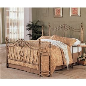 This Queen size Metal Bed with Headboard and Footboard in Antique Brushed Gold Finish will make a stunning centerpiece in your transitional style master bedroom. The bed has a high curved headboard and footboard with elegant curved crowns and swirling floral motifs. The wraparound design has a timeless classic look and a comfortable feel. Simple smooth oval finials and trumpet feet complete the piece, creating an understated style. In a warm Antique Brushed Gold, this bed will blend nicely with different styles of decor, from more traditional to casual, making this a great choice for your home. Pair with the matching nightstand for a complete ensemble.