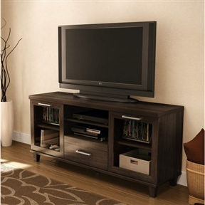 This 59-inch TV Stand in Hazy Brown Finish - CARB compliant is ergonomically designed to place your television at the ideal height. It features framed doors with windows, decorative legs and a thick hollow top, making it easy to reposition. It can accommodate a TV up to 60-inch and its weight capacity is 185 pounds. Features 2 closed compartments behind frame doors with windows divided by an adjustable shelf 1 practical drawer with a fixed shelf above it. The drawer is equipped with metal slides for smooth gliding and a metal handle in stainless finish. For complete interior dimensions see spec sheet. A fith leg has been added for enhanced sturdiness.
