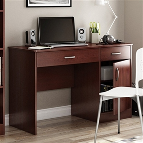 A handsome place to check your email or pay bills, this Modern Home Office Computer Desk in Royal Cherry Finish has clean lines and ample enclosed storage. Right-sized for any home, this desk is made of sturdy laminate with a royal cherry finish. It has a two drawers and one cupboard door that opens to reveal an adjustable shelf behind. The desktop provides a spacious working area and a wire management cut-out hole at the back keeps things tidy.