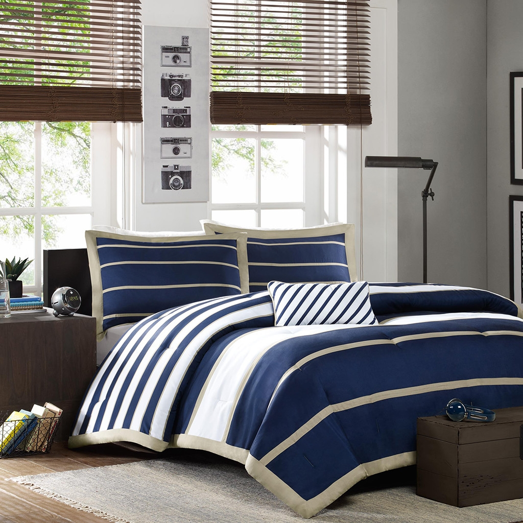 This Full / Queen size Comforter Set in Navy Blue White Khaki Stripe is designed to offer a luxurious and comfortable night's sleep. This comforter set mingles well with any type of home setting, be it modern, traditional or contemporary. This amazing comforter will enhance the look of your bedroom instantly. Soft and inviting, this set of comforters is great for year-round display. The spectacular comforter twin extra long comforter includes 1 comforter, 1 sham and 1 pillow. The full/queen comforter set includes 1 comforter, 2 shams and 1 pillow. This product is made using high quality materials. The striped pattern of this comforter lends an elegant and timeless charm to your room. The comforter set is a stunning combination of looks and functionality. Its white and navy color stripped pattern looks impressive and stunning. This comforter set will blend perfectly with dark brown interiors. It's the perfect pick for your master bedroom or guest room. Cozy and stylish, this comforter set is sure to leave you spell bound. It's your perfect companion for those cold wintery nights when you just want to relax and sleep or read your favorite book. Cleaning Method: Machine washable; Drying Method: Tumble dry; Country of Manufacture: China. Duvet Cover/Comforter: Yes; Duvet or Comforter Material: Polyester; Duvet or Comforter Color: Navy; Duvet or Comforter Pattern: Striped.