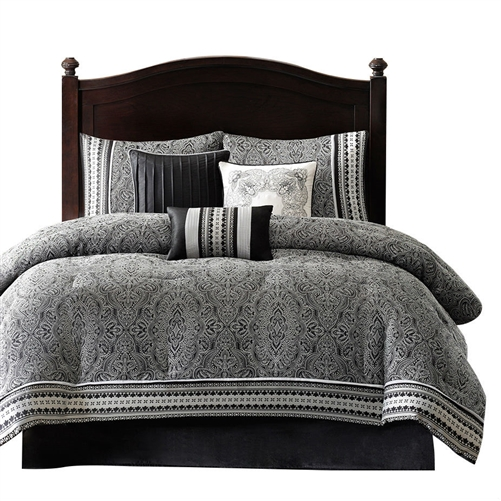 This Queen size 7-Piece Comforter Set in Black White Grey Damask Pattern is sure to add elegance in your room. This set has a stylish appeal that will enhance the looks of your bedroom decor. It is a nice addition to any home. Beautifully created from polyester, this comforter set is soft and warm. It has a nice black color, which makes it stand out in the bedroom while enhancing the overall looks of the interiors. This comforter set is available in different sizes, which helps you to choose the perfect fit for your bed. This attractive comforter set includes one comforter, a bed skirt, two shams, and three pillows that complete your bed. This beautiful set is reversible, which adds to its functionality. It is a perfect addition for your home and can also be given as a wonderful housewarming gift. It is a must-have for those who love embroidered designs on their bed accessories. This Queen size 7-Piece Comforter Set in Black White Grey Damask Pattern is easy to care for. It can be cleaned with a machine wash in cold water, on a gentle cycle, and tumble dried when needed.