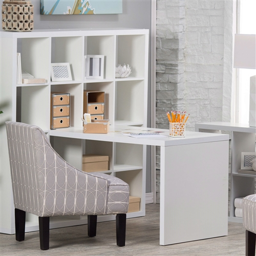 This Modern Computer Desk with Honeycomb Style Wall Bookcase in White brings efficient storage and a comfortable work surface to the home or office. A wonderfully versatile piece, the desk and shelf combo is designed to be used against a wall or at the very center of a room. The impressive bookcase serves as a splendid organizer and room divider with its great height and 16 evenly divided compartments. These 16 cubes are open for convenient retrieval of stored items or showcasing mementos and collectibles, leaving them on display for all to see. Connected to this towering shelf is a desk with matching honeycomb construction and MDF and melamine surface finished in a crisp white that complements any decor. The desk is quite spacious, with enough room for a computer, important files, arts and crafts, and much, much more. The overall look is undeniably modern and sure to give your work area an eye-catching update.