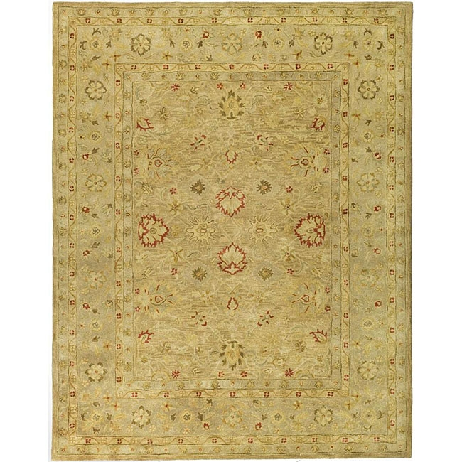 Handmade Majesty Light Brown/ Beige Wool Rug (7'6 x 9'6), HMLBWR7696 :  This hand-tufted rug features a light brown background with a beige border. This traditional rug is made from New Zealand wool pile. Tip: We recommend the use of a non-skid pad to keep the rug in place on smooth surfaces. All rug sizes are approximate. Due to the difference of monitor colors, some rug colors may vary slightly. We try to represent all rug colors accurately. Please refer to the text above for a description of the colors shown in the photo. Fringeless borders give a very clean look and feel; Professional cleaning recommended; Primary color: Beige; Pattern: Oriental.