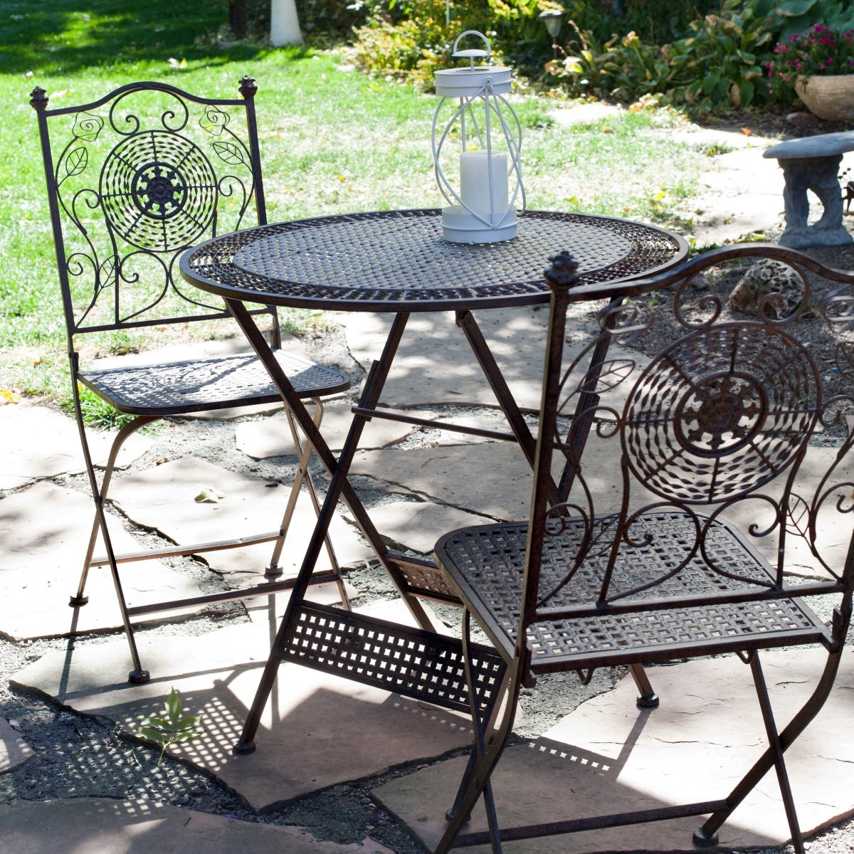 3-Piece Folding Outdoor Patio Furniture Bistro Set in Antiqued Iron, 3PAIFBS199 :  Create a romantic little tea time for two in just seconds with this 3-Piece Folding Outdoor Patio Furniture Bistro Set in Antiqued Iron. Crafted of Iron and finished in a aged-rustic Bronze, this 3-piece bistro set has an Old World flavor that's sure to set the mood for great conversation. The table and two bistro chairs are elaborately detailed and they all fold flat for easy storage. This means you can enjoy the ambiance of this set when you want to and enjoy the extra space on your patio when you need it. It's a snap to set up and take down. Iron construction and a aged-rustic Bronze finish; Striking table top features 2 decorative patterns; 2 armless bistro chairs with ornately decorated backs; All 3 pieces fold up flat for easy storage.