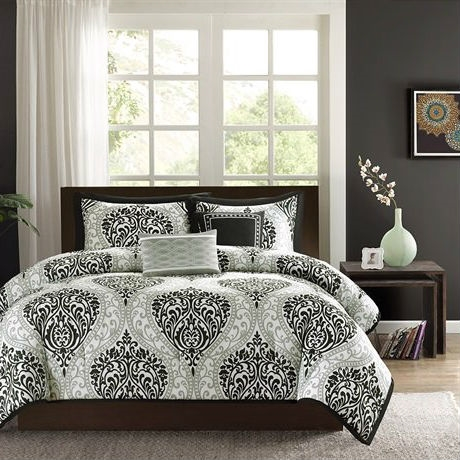 This California King size 5-Piece Black White Damask Comforter Set is the perfect way to make a fashion statement in your bedroom. The large black and gray damask print creates a dramatic look with this comforter.