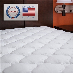 "You'll love the luxurious comfort of this mattress pad! Top-quilted bamboo blend fabric is silky to the touch and is extra plush for a more comfortable sleep. The bamboo fabric breathes extra well and can even help cool down those extra warm mattress (perfect to counterbalance warm mattresses such as Tempurpedic). This is the highest rated mattress pad on all of Amazon. Top is 70% polyester/30% rayon from bamboo and is filled with plush, supportive synthetic cluster fiber. Cluster fiber is a highly innovative polyester material that goes through an extra engineering process to create balls of fiber that ""trap"" air to allow the pad to keep its shape longer and allow more air flow than any other pad on the market. Backing is 50% cotton/50% polyester."