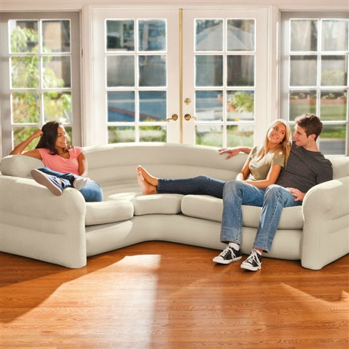 """The Cream Inflatable Indoor/Outdoor Corner Sofa is a fantastic addition to any living room with spacious seating and a neutral color to suit any home decor. Luxurious, yet convenient, this couch is designed with deep seats and wide armrests for a practical and sophisticated appeal. Designed with a waterproof-flocked top surface and a vinyl bottom, this sofa provides an incredibly comfortable sitting surface for any occasion. A 2-in-1 valve with extra-wide openings ensures fast inflating and deflating. Upon deflating, the Corner Sofa folds compactly for storage or travel. Approximate inflated size 101"""" x 80"""" x 30"""". Weight capacity 880 lbs."""