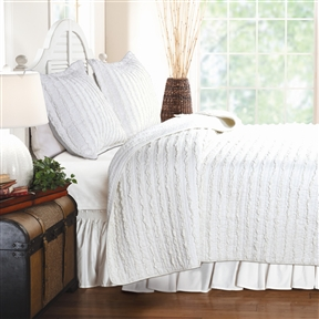 This King size 3-Piece Quilt Set with 2 Pillow Shams 100% Cotton White Ruffles has rows of soft cotton ruffles carefully pieced and quilted in pre-washed white-colored 100% cotton. Create a romantic look with this ruffled quilt set. Cozy and comfortable, this set reverses to a matching solid color in 100% cotton for easy sophistication and refined, relaxed living. Sham Material: Cotton Reverse Side; Color: White; Pattern: Striped; Country of Manufacture: China.