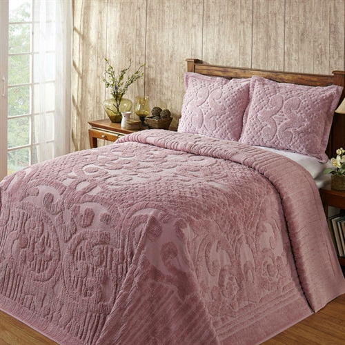 This Full size 100-Percent Cotton Chenille Bedspread in Pink - Machine Washable will make your bedroom cozy and warm with its pleasing colors and pattern. It has a solid color with tufted scrolls, lines and dots.