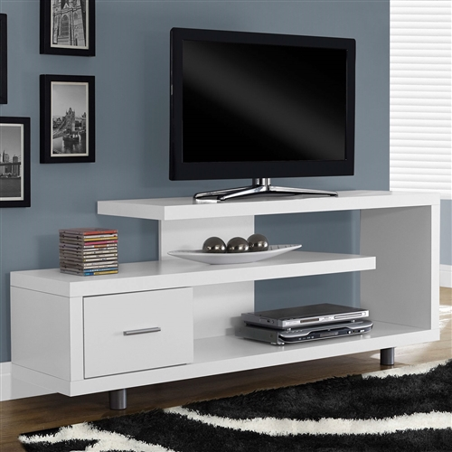 Like a piece of art right in your living room, this White Modern TV Stand - Fits up to 60-inch Flat Screen TV is just as beautiful as it is functional. This art-deco inspired TV console is constructed of durable MDF, hollow-core board, and laminate in your choice of finish. It accommodates a flat-panel television up to 60 inches, and its open-concept shelving allows your to display your favorite decorative items as well as electronic components. The single storage drawer also provides a convenient space to tuck away DVDs, electronics, and more. This stylish TV console is so much more than just a place to hold your television; it makes a stunning impact and enhances the existing decor of your modern home.