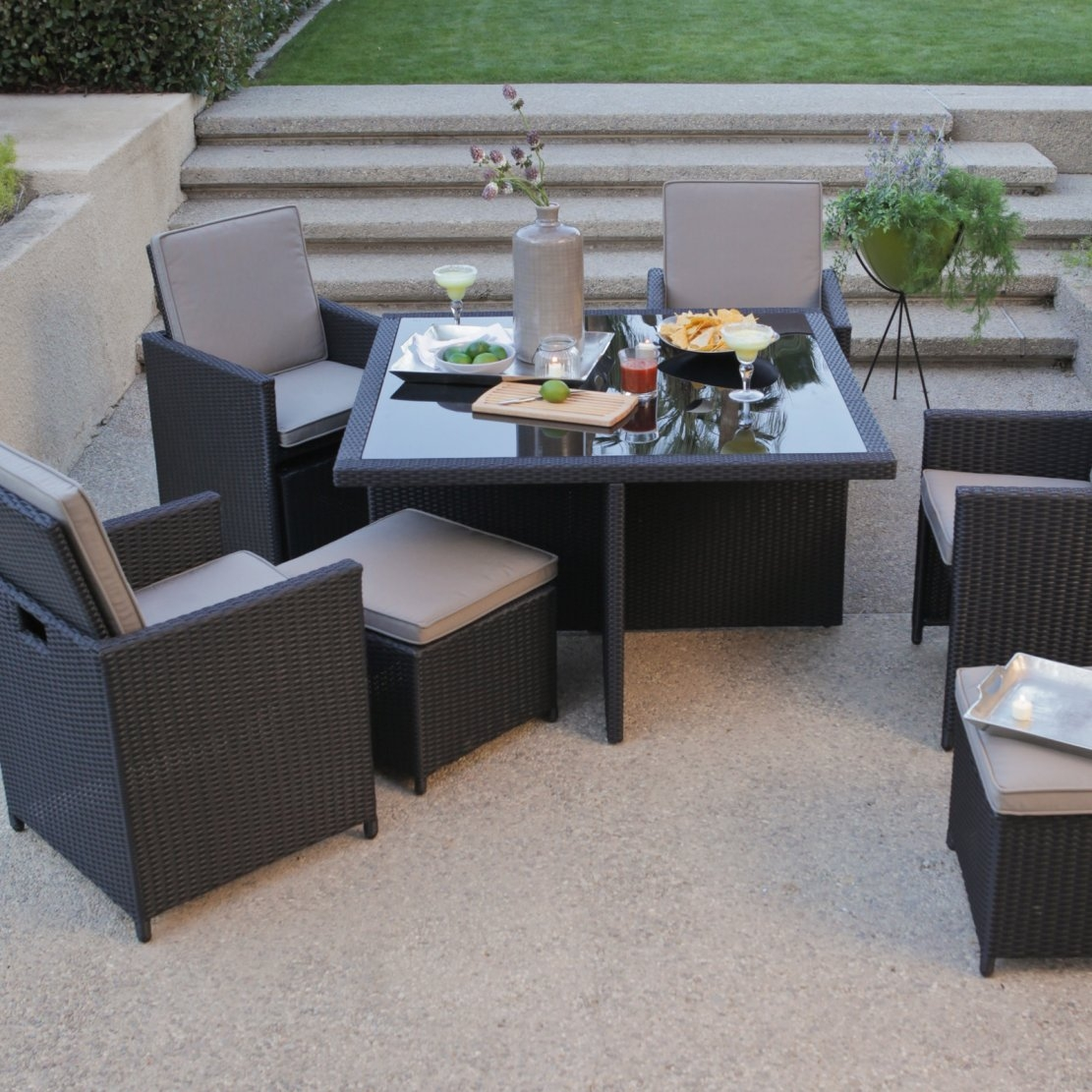 All-Weather Wicker Nesting Patio Furniture Dining Set - Seats 4, KAWD1399 :  This All-Weather Wicker Nesting Patio Furniture Dining Set - Seats 4 is a must-have for those who want style and functionality; its all-weather design has a nesting feature that's a real space saver. This unique dining set includes a glass-topped table with four chairs and accompanying ottomans. The nesting option allows the ottomans to be stored neatly under their chairs, and the chairs can nest under the table to form a cube. Its all-weather resin wicker construction comes in dark espresso and is complemented with weather-treated beige cushions. Hose off to clean; Spot clean cushions; Rich, dark espresso all-weather resin wicker construction; Sturdy, rust-resistant aluminum frame; Cushions made of weather treated polyester; Includes dining table, 4 chairs, and 4 ottomans.
