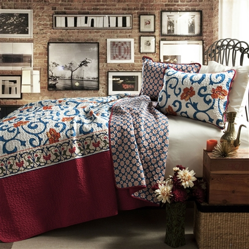 Made from 100% cotton this King size 3-Piece Cotton Quilt Set in Red White Blue Floral Scroll Pattern is soft to the hand and has wonderful quilting details. When placed on the bed, the top portion of the quilt features a subtle scroll floral pattern, while the sides are a complementary solid color. The reversible quilt allows for variety in the design. Imported.