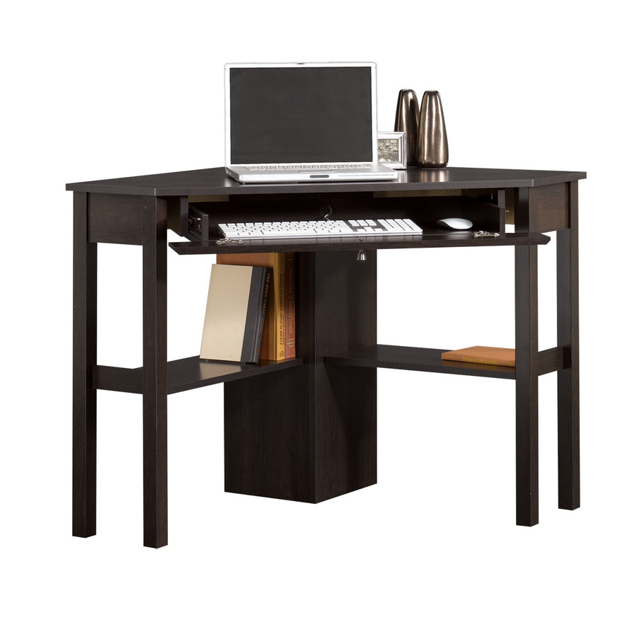 This corner computer desk good looking office desk at a great value that does the job in any setting. Perfect for new businesses, young people, kid's rooms, basements or anywhere that requires an affordable space saving corner desk. Finish: Cinnamon Cherry dark wood finish looks similar to an espresso or cappuccino finish. Material: Engineered wood; Scratch Resistant non-toix finish; 1 Drawer; Nickel finish hardware; FSC EPP and ISTA 3A Certified; CARB Compliant; Great for Home office or professional. Design: Triangular Corner Desk.