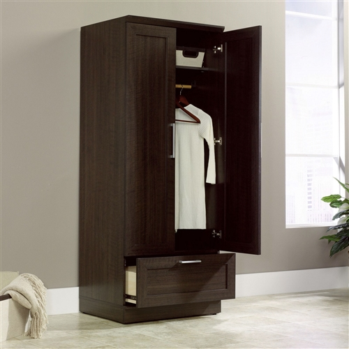 It's easier than ever to bring more storage into your home, thanks to this Bedroom Wardrobe Armoire Cabinet in Dark Brown Oak Wood Finish. This sleek storage cabinet offers an adjustable shelf, a garment rod, and a smooth design that looks great everywhere. Try it in the laundry room for clothes, hampers, detergents, and other items. Available in a robust Dakota oak finish or bright sienna oak finish. Crafted of durable engineered wood.