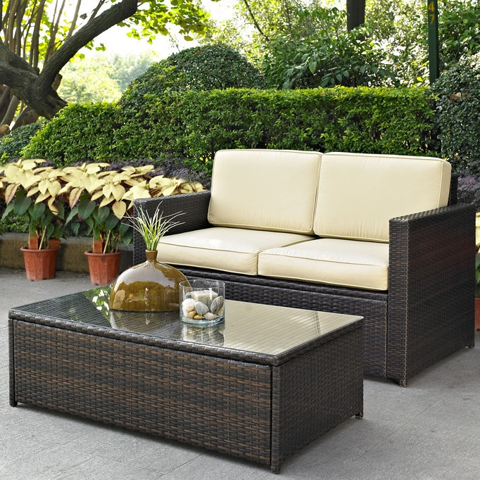 2-Piece Outdoor Patio Furniture Set with Loveseat and Glass Top Table, CPSG389 :  Set your ice cold beverage on the table and lounge around on this 2-Piece Outdoor Patio Furniture Set with Loveseat and Glass Top Table. Finely crafted with intricately woven wicker over durable aluminum frames, this timeless wicker furniture provides lasting comfort and style. Let your worries fade away as you doze off in our UV/fade resistant cushions. Use a soft clean cloth that will not scratch the surface when dusting. Use of furniture polish is not necessary. Should you choose to use a furniture polish, test in an inconspicuous area first. Use of solvents of any kind could damage your furniture's finish. To clean, simply use a soft cloth moistened with lukewarm water, then buff with a dry soft clean cloth.  Water repellent cushions; Set includes loveseat and tempered glass top cocktail table; Weather Resistant Details: Weather resistant; Detachable Cushion: Yes; Water Resistant Details: Water resistant; Assembly Required: Yes; Product Warranty: 3 Month limited; Woven Material: Resin wicker Woven: Yes; Upholstery Material: Sunbrella; Welt on Cushions: Yes; Cushion Fill Material: Foam. Individual Chair Weight Capacity: 250lbs. Style: Modern; Pieces Included: Loveseat, Cocktail table. Sofa Depth - Front to Back: 29 Inches; Sofa Width - Side to Side: 53 Inches; Sofa Height - Top to Bottom: 33.25 Inches.