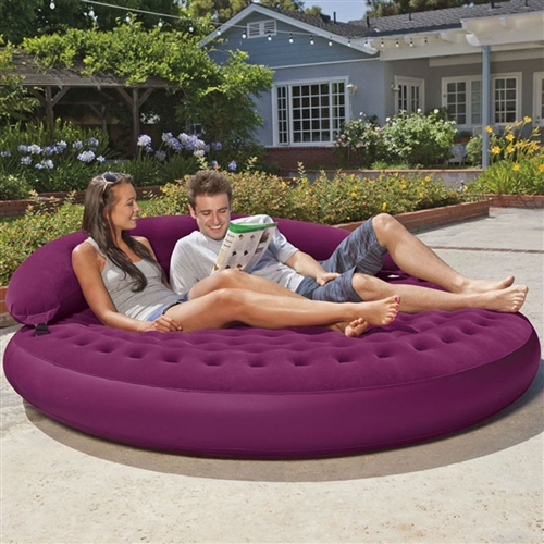 The Inflatable Purple Indoor/Outdoor Detachable Backrest Circle Daybed Lounge invites you to relax, soak up the sun and hang out with friends. It's an elegant addition to any room, patio or yard as the reinforced bottom and soft flocking makes it versatile enough for both the indoors and outdoors.