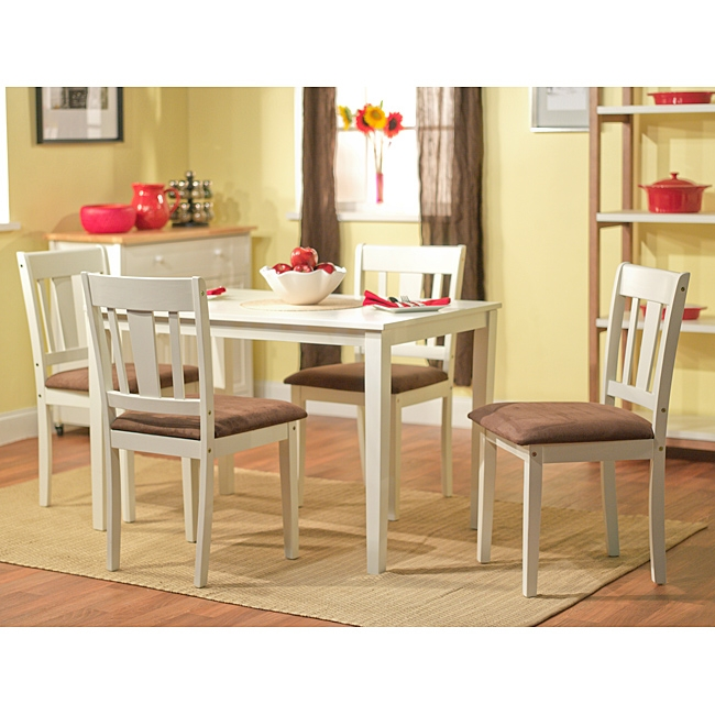 Enhance yoru dining or kitchen area with this White 5-Piece Dining Table and Chairs Set. This set features clean and simple lines perfect for any decor. Table and chairs have a chic white finish that will enable you to incorporate this set into a formal or casual setting.