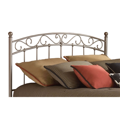 This King size Arched Metal Headboard with Cylindrical Posts shows a refined poise perfect for anyone seeking simplicity with just a touch of character. The profile of the grill carries a gentle arch across the top with fanciful swirls just beneath. The simplicity of the vertical spindles make sure that the bed maintains a certain calm. One should note that each of these vertical elements is fixed into place with a solid casting. Its Brown finish completes the headboard. Vertical spindles, rounded finials, and solid castings complete the look.