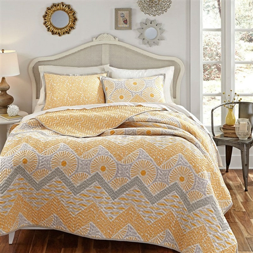 Rise and shine with the Full / Queen 3 Piece Geometric Sunset Oversized Cotton Quilt Set on your bed. This quilted ensemble includes radiant geometric patterns in sunset gold and dove gray that reverses to an all-over gold leaf print. This ensemble includes the reversible quilt and one to two pillow shams, depending on the size you order. Everything's made of 100% luxurious cotton and is conveniently machine-washable.