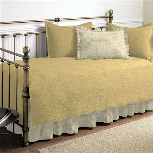 This Twin size 100-Percent Cotton 5-Piece Quilt Set for Daybeds in Yellow is an elegant and stylish bed set that can provide a comprehensive makeover to the most ordinary of bedding arrangements. If a change of scenery is what you desire, then this quaint set of bedding accessories is the answer. Made entirely from 100% cotton, the Twin size 100-Percent Cotton 5-Piece Quilt Set for Daybeds in Yellow in Yellow Cotton flaunts a soft and plush feel without sacrificing any of the lasting durability that Stone Cottage is known for. The entire set consists of a quilt, a quilt sham to go with it, two ruffled standard shams, and a bed skirt. The bed skirt features split corners, so that it fits naturally around any corner posts that your furniture may have. The quilt is embroidered with patterns in the same shade as the parent color, keeping in line with the subtlety of this bed set. Scalloped edges define the borders of the quilt and add to its decorative capacity. The quilt sham is endowed with the same striped design as the quilt, which is something unique to these two parts of the bed set only, and provides a telling contrast to the solid shade borne by the other three. This extensive bed set is machine washable making it easy to care for. It is available in multiple colors, letting you choose one that best fits the existing room decor.